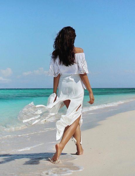 Girl walking at the beach